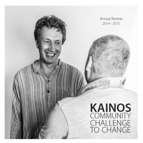 Kainos Annual Review 2014-15 front cover - a support worker is smiling at a resident