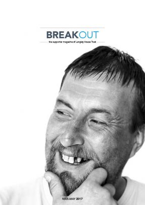Front cover of supporter magazine, Breakout, March-May 2017. White man with a short moustache and beard, with a tooth missing, holding his chin in his hands, looking slightly to the right and smiling