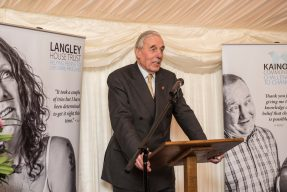 Lord Ramsbotham, host of Langley and Kainos' Annual Review Launch 2016, standing at a podium about to speak