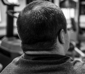 Back of the head of a man in prison